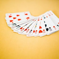 Spread of Playing Cards in Yellow Background
