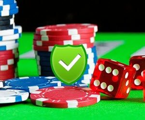 Casino Chips And Dice With Green Tick Badge