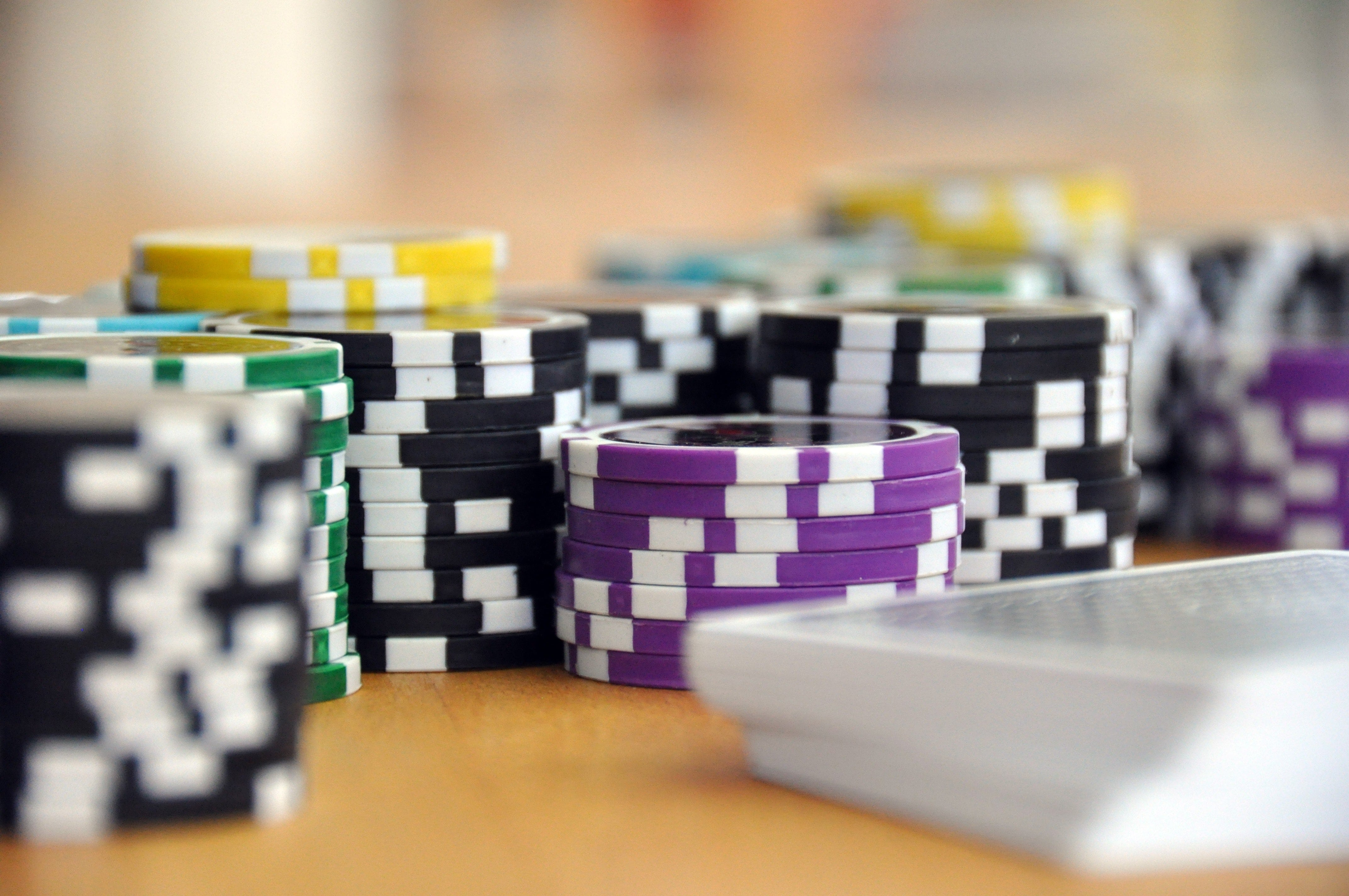 Casino Chips And Pack Of Cards On Table